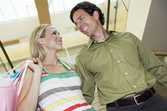 Cheerful Couple Looking At Each Other In Shopping Mall Royalty Free Stock Photos