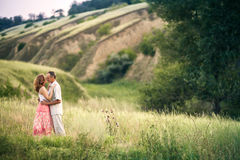 Cheerful couple in love standing below of ravine Royalty Free Stock Images