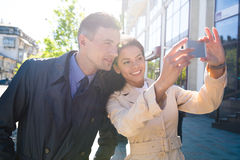 Cheerful couple making selfie photo in the city Stock Photography