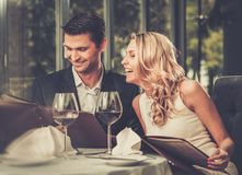 Cheerful couple with menu. stock images