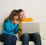Cheerful couple with notebook Royalty Free Stock Image