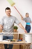 Cheerful couple painting their home Royalty Free Stock Photo