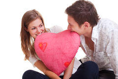Cheerful couple with pink heart Royalty Free Stock Photo
