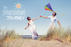 Cheerful Couple Playing Kite by the Beach Royalty Free Stock Image