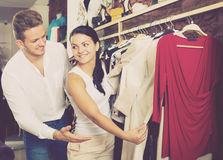Cheerful couple purchasing dress and blouse Stock Image