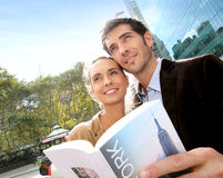 Cheerful couple reading new york's guide and sightseeing Stock Image