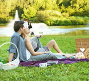 Cheerful couple relaxing in the park Stock Image