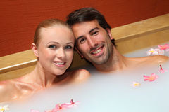 Cheerful couple relaxing in spa Royalty Free Stock Photo