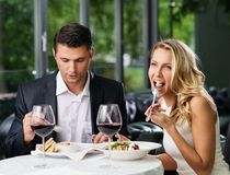 Cheerful couple in a restaurant Stock Photography