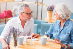 Cheerful couple resting in the cafe Royalty Free Stock Image