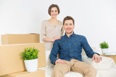 Cheerful couple resting on the sofa Royalty Free Stock Image