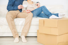 Cheerful couple resting on the sofa Royalty Free Stock Photography