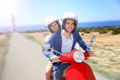Cheerful couple riding moto on island Royalty Free Stock Photo