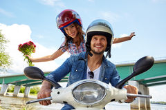 Cheerful couple riding vintage scooter. Royalty Free Stock Photo
