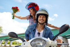 Cheerful couple riding vintage scooter. Royalty Free Stock Photos