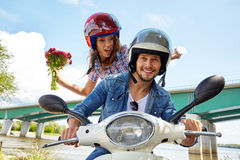 Cheerful couple riding vintage scooter. Stock Image