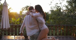 Cheerful Couple Run On Terrace Spinning At Sunset On Summer Terrace, Happy Young Man And Woman In Love Embracing stock video footage
