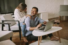 Cheerful couple searching internet and shopping online stock photo