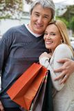 Cheerful Couple With Shopping Bags Stock Images