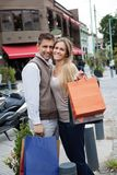 Cheerful Couple With Shopping Bags Stock Photography