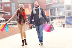Cheerful couple shopping in the city Stock Photo
