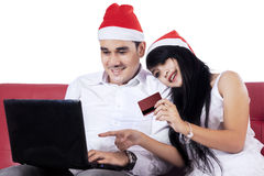 Cheerful couple shopping online together Stock Image