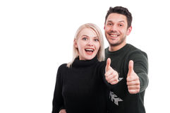 Cheerful couple showing thumbs up. Or like sign with copytext on white background Royalty Free Stock Photo