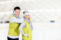 Cheerful couple in the skating rink Royalty Free Stock Images