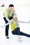 Cheerful couple on the skating rink stock images