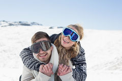Cheerful couple in ski goggles on snow Royalty Free Stock Image
