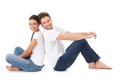Cheerful couple smiling happily on floor stock photos