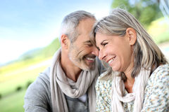 Cheerful couple smiling together at camera Stock Photo