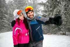 Cheerful couple snowboarder enjoying at ski resort in the mounta royalty free stock photos