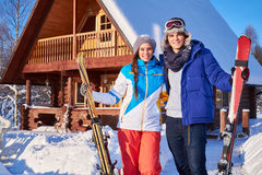Cheerful couple spend winter holidays at mountain cottage Stock Images