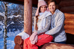 Cheerful couple spend winter holidays at mountain cottage Royalty Free Stock Photo