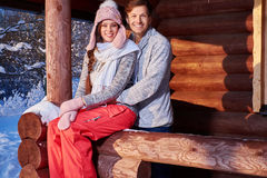 Cheerful couple spend winter holidays at mountain cottage Royalty Free Stock Photography