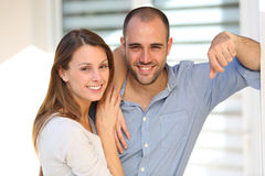 Cheerful couple standing in front of their new home Royalty Free Stock Images