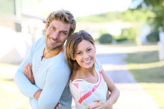 Cheerful couple standing in new property Stock Image