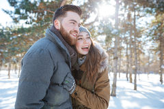 Cheerful couple standing in winter park Royalty Free Stock Photos