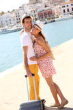 Cheerful couple with suitcase in Ibiza Royalty Free Stock Photo