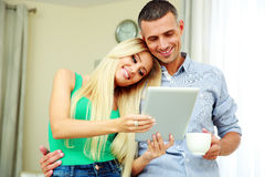 Cheerful couple with tablet computer Stock Photo
