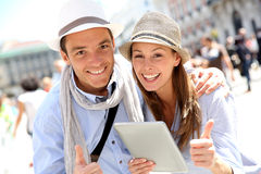 Cheerful couple with tablet Stock Photography