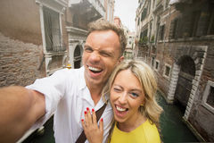 Cheerful couple taking funny selfie picture Royalty Free Stock Images
