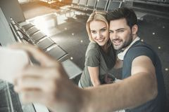 Cheerful couple taking photo by phone stock photos