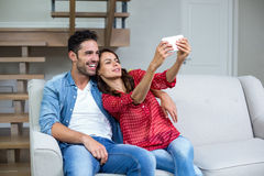 Cheerful couple taking self portrait Royalty Free Stock Images