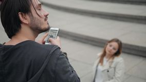 Cheerful couple taking selfie in green park, man take fashion photo on phone of girlfriend. Cheerful couple taking selfie in green park stock footage