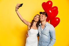 Free Cheerful Couple Taking Selfie On Smartphone While Celebrating Valentine`s Day Stock Photography - 107698172