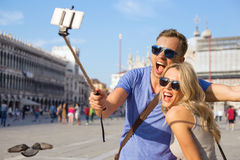 Cheerful couple taking selfie photo with smartphone Royalty Free Stock Photo
