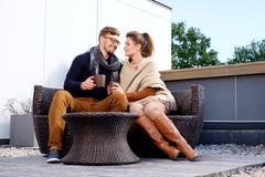 Cheerful couple on a terrace Stock Photo