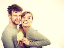Cheerful couple together with building model Stock Image